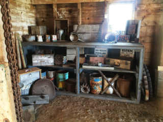 Antique containers, signs and bottles