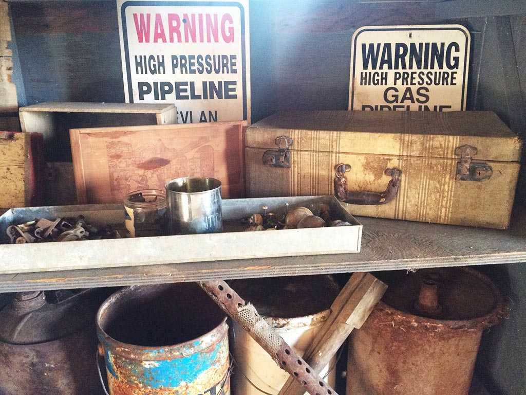 Antique suitcase and signs