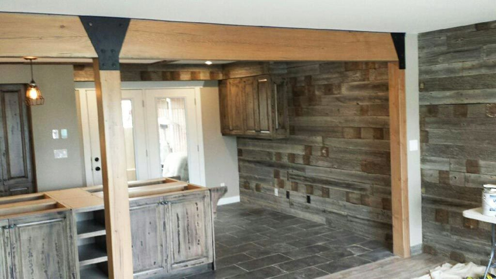 Reclaimed barnwood feature wall in a kitchen