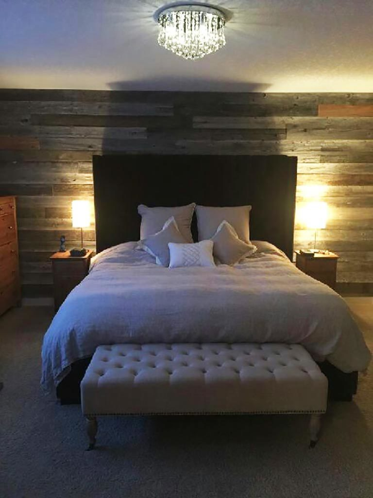 Reclaimed barnwood feature wall in a bedroom