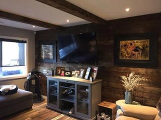 Reclaimed barnwood accent wall in a living room