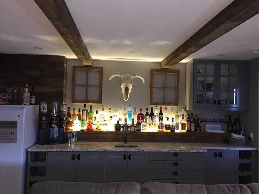 Reclaimed barnwood accents in a bar