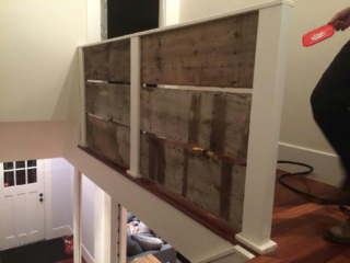 Reclaimed barnwood accent on a railing