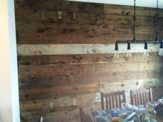 Reclaimed barnwood accent wall in a dining room
