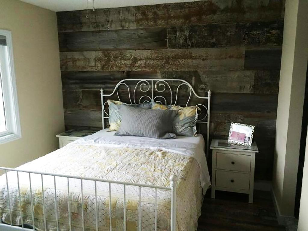 Reclaimed barnwood accent wall in a bedroom
